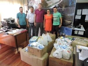Secretários Rafael Rufino e Ivete Correa no ato de repasse dos alimentos